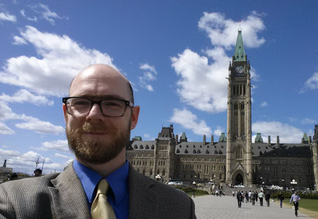 Mike Toye in front of the Canadian parliament
