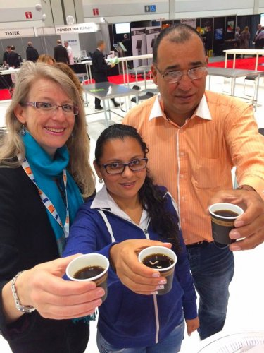 Philippa testing coffee with Colombian producers in Toronto