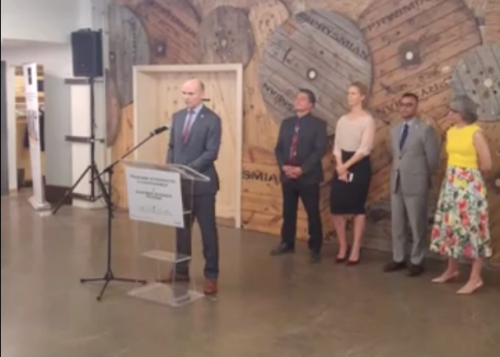 Jean-Yves Duclos makes the announcement on Wednesday as Shannin Metatawabin of National Aboriginal Capital Corporations Association, Béatrice Alain of le Chantier de l'économie sociale, Andrew Chunilall of Community Foundations Canada, and ??? of the Canadian Women's Foundation look on.