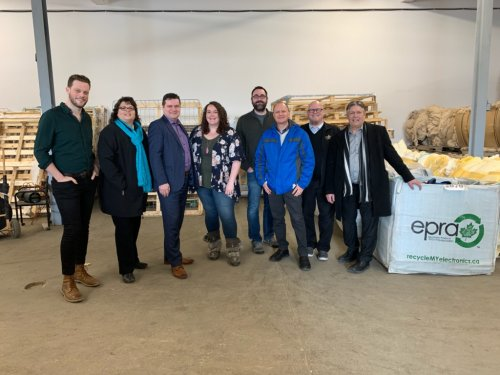 CCEDNet Policy Coordinator Michael Barkman (far left) atours MLA's through Mother Earth Recycling (MER) with MER General Manager Jessica Floresco