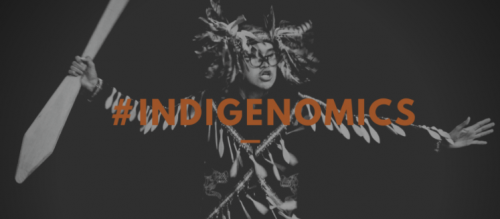 """Image of Indigenous person dancing with text: """"#INDIGENOMICS"""""""