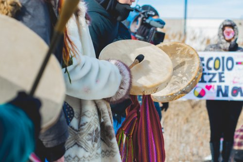 Image of Indigenous people playing drums at solidarity rally for Wet'suwet'en